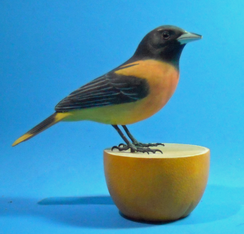 Baltimore Oriole On Orange Wood Carving